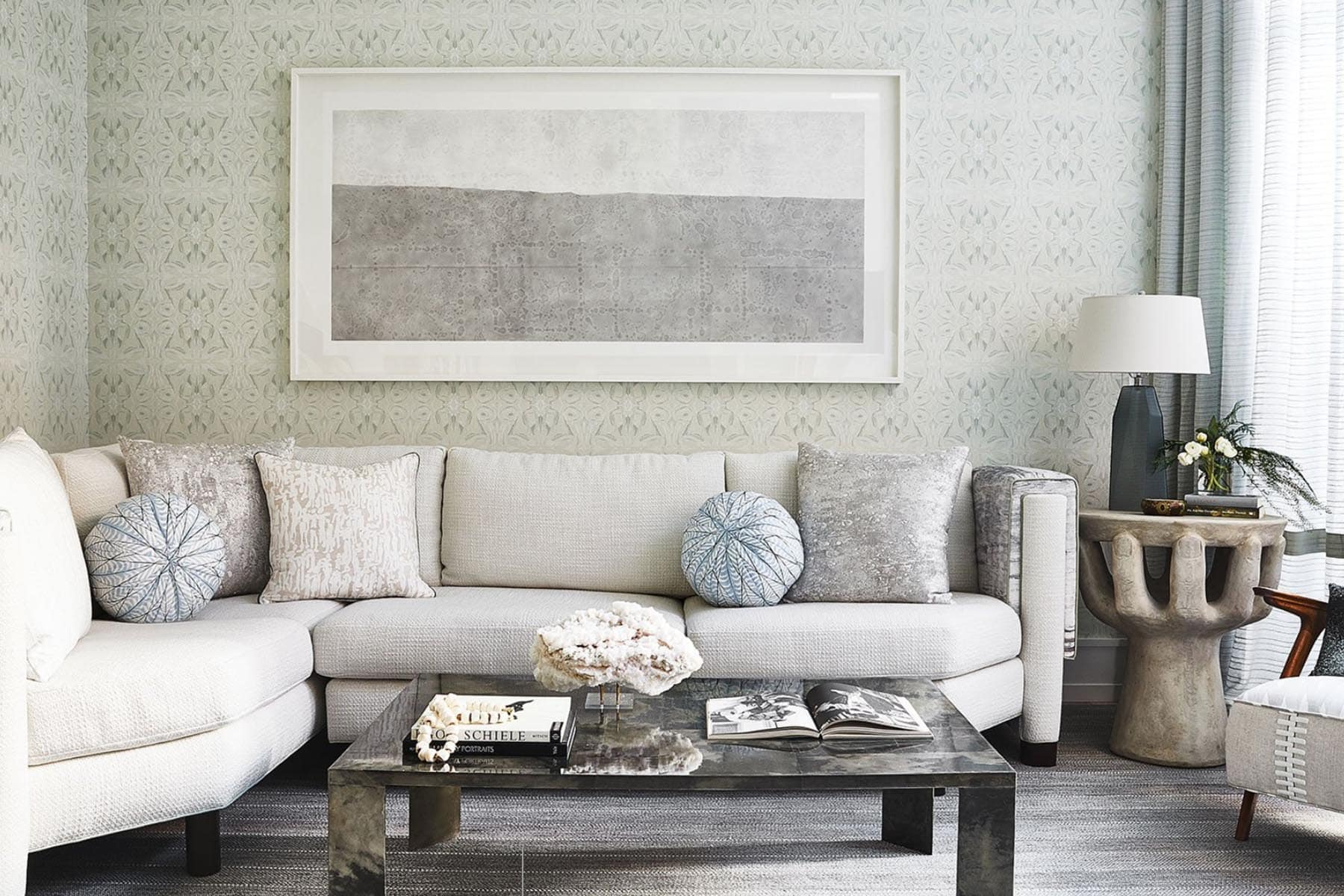 white living room cough with wall paper